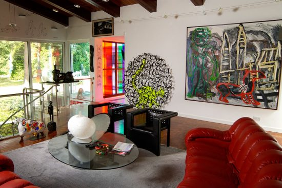Back sitting room at 'Bleep', Eric and Jean Cass's modernist Surrey home, where the artworks were previously displayed. Photo: Douglas Atfield: showing a work by Dutch artist Karel Appel 'The City' which will now be on display at National Museum Cardiff.