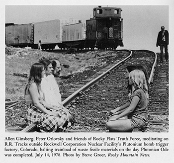 Allen Ginsberg, Peter Orlovsky and friends of Rocky Flats Truth Force, meditating on R. R. Tracks outside Rockwell Corporation Nuclear Facility's Plutonium bomb trigger factory, Colorado, halting trainload of waste fissile materials on the day Plutonian Ode was completed, July 14, 1978. © photo: Steve Groer, Rocky Mountain News