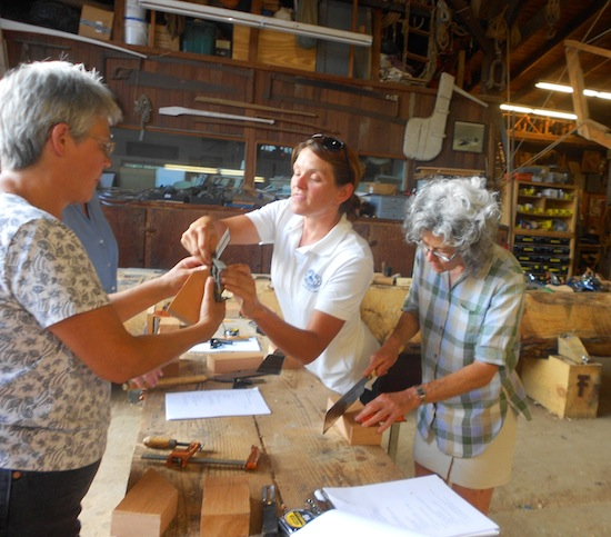 CBMM Boatyard Program Manager Jenn Kuhn explains the intricacies of woodworking to two participants in a recent woodworking workshop at the Chesapeake Bay Maritime Museum in St. Michaels, MD.