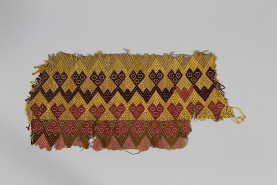 Woven patterned textile (fragment), Peru, circa 16th century, 9.5 x 6.3 cm, wool, cotton. Courtesy of Center for Social Research on Old Textiles.
