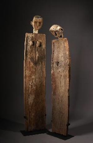 Sukuma, Tanzania, Guardian Post, pair, circa 1900, wood, metal, hide, 82 x 16; 74 x 16 inches, respectively. Private Collection, USA