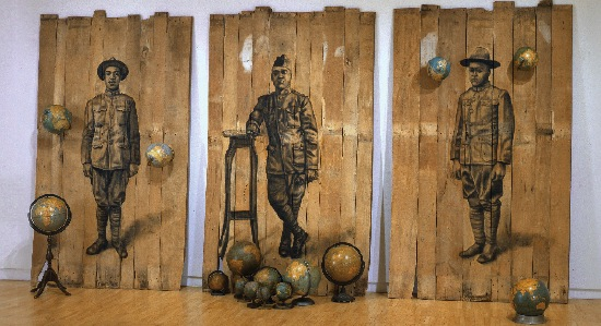 WHITFIELD LOVELL (B. 1959), AUTOUR DU MONDE, 2008, CONTE ON WOOD PANELS WITH GLOBES, 102 X 189 X 171 INCHES, COURTESY OF THE ARTIST AND DC MOORE GALLERY, NEW YORK
