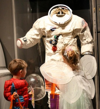 Costumed visitors to The Museum of Fright ponder an Apollo space suit. Ted Huetter/The Museum of Flight.