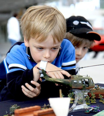 Boys inspect model helicopter and soldiers at Northwest Historical Miniatures Gaming Society exhibition. Ted Huetter/The Museum of Flight.