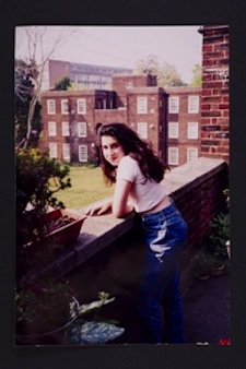A young Amy outside her Grandma's flat in Southgate. Photographer unknown © The Winehouse family.