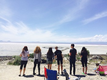 AP Art History students from Bingham High School at Rozel Point, Great Salt Lake, Utah | Robert Smithson, Spiral Jetty, 1970, black basalt rock, salt crystals, earth, water.