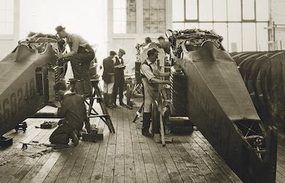 Working on airplanes in the original Boeing factory in the 1910s.