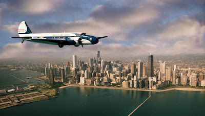 The Museum's Boeing 247D over the Chicago skyline in the late 1990s. Museum of Flight photo.
