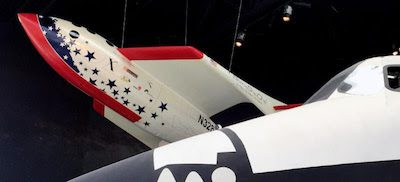 SpaceShipOne replica looms over the Space Shuttle Trainer at The Museum of Flight.